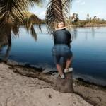 Billy tries climbing a palm tree at Camana Bay
