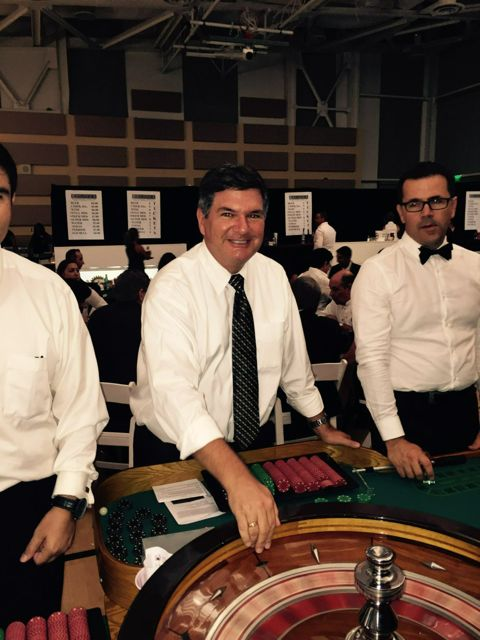 Pat serving as croupier
